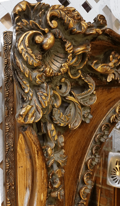 Rococo frame - corner close-up showing faux wood finish.